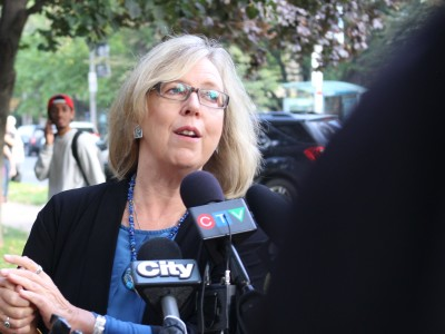 "Elizabeth May: Harper is ""converting the Canadian spy agency into a secret police with virtually unlimited powers."""