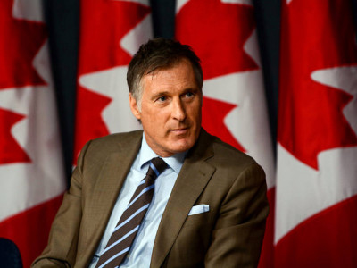 "Maxime Bernier: ""The Global Compact for Migration commits Canada to developing all kinds of programs to deal with migration"" and ""ensure they have jobs."""